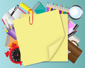 Yellow paper and school objects Stock Photo