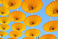 Yellow paper umbrella  floating in the blue sky. Royalty Free Stock Photo