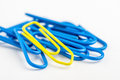 Yellow paperclip with lots of blue Stock Photography