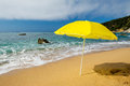 Yellow parasol at the beach Stock Image