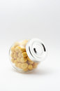 Yellow peanuts in jar with cover Royalty Free Stock Image