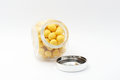Yellow peanuts in jar with cover Royalty Free Stock Images