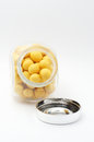 Yellow peanuts in jar with cover Royalty Free Stock Photography