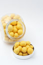 Yellow peanuts in jar with cover Stock Photo
