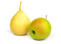 Yellow pear and green apple. Royalty Free Stock Photo
