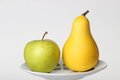 Yellow pear and green Apple on white background Royalty Free Stock Photo