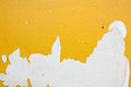 Yellow peel off from the surface of the plaster. Stock Photo