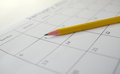 Yellow pencil on open calendar Royalty Free Stock Photo