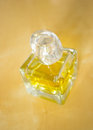 Yellow perfume bottle standing on table Stock Photos