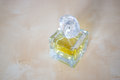 Yellow perfume bottle standing on table Royalty Free Stock Photos