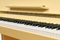 Yellow piano keyboard Stock Image