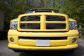 Yellow pick up truck front and grill of a big Royalty Free Stock Photo
