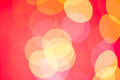 Yellow on pink bokeh background Stock Images