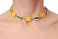 Yellow plastic necklace on female neck Royalty Free Stock Photo