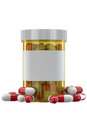 Yellow plastic phial with pills filled red and white on white background front view Royalty Free Stock Photos
