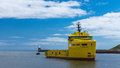 Yellow platform supply ship and pilot oil returning into harbour Royalty Free Stock Photography