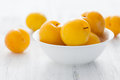Yellow plums bowl Royalty Free Stock Image