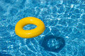 Yellow pool float, pool ring in cool blue refreshi