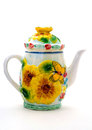 Yellow porcelain teapot with ornament flowers and butterfly. Royalty Free Stock Photo