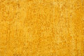 Yellow porous wall for background or texture Stock Images