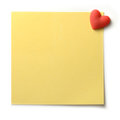 Yellow post note with heart pin studio macro of textured pinned to a white background a red shaped copy space Royalty Free Stock Photos