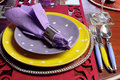 Yellow and purple table place setting close up beautiful dining for fun birthday thanksgiving christmas or special occasion with Royalty Free Stock Photo