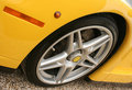 Yellow race car wheel Royalty Free Stock Photo