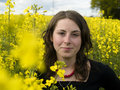 Yellow rape field and young girl Stock Photos