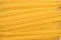 Yellow raw dry spagetti, background, texture Royalty Free Stock Photo