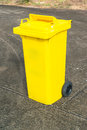Yellow recycle bin on the road side Royalty Free Stock Images