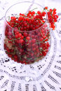 Yellow and red currant in balloon wine glass Royalty Free Stock Photo