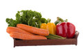 yellow red green pepper Carrot and parsley in a basket isolated Royalty Free Stock Photo