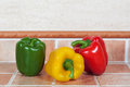 Yellow red and green peppers in the kitchen Royalty Free Stock Photography
