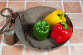 Yellow red and green peppers in a romane scale Royalty Free Stock Photography