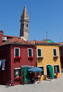 Yellow and red houses in burano italy with the medieval campanile the background an island near venice is well known Stock Photography