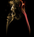 Yellow and red light smoke on a dark background Royalty Free Stock Photo