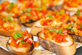 Yellow and red tomatoes bruschetta Stock Photography
