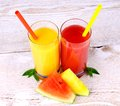 Yellow red watermelon and juice with straw top view Stock Images