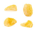 Yellow ribbed potato chips isolated over the white background set of four different images Royalty Free Stock Image