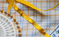 Yellow ribbon pinned to cotton cloth Royalty Free Stock Photo
