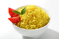 Yellow rice dish a portion of cooked served with greens and tomatoes in white ceramic bowl Royalty Free Stock Photo