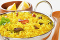 Yellow rice lemon with cashew nuts and raisins Stock Photos