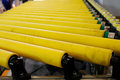 Yellow roller conveyer Royalty Free Stock Photo