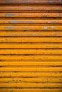 Yellow roller shutter door texture Royalty Free Stock Photo