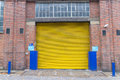 Yellow roller shutter Royalty Free Stock Photo