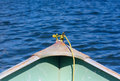 Yellow rope in front of a shallop on a lake Royalty Free Stock Photo