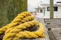 Yellow Rope Wrapped Around Post on Pier Royalty Free Stock Photo