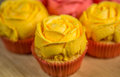 Yellow rose frosting cupcakes on a pastry board Stock Images