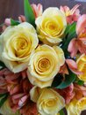 Yellow roses  and orange  tiger lilies Royalty Free Stock Photo