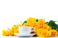 Yellow roses and white coffee cup Stock Photo